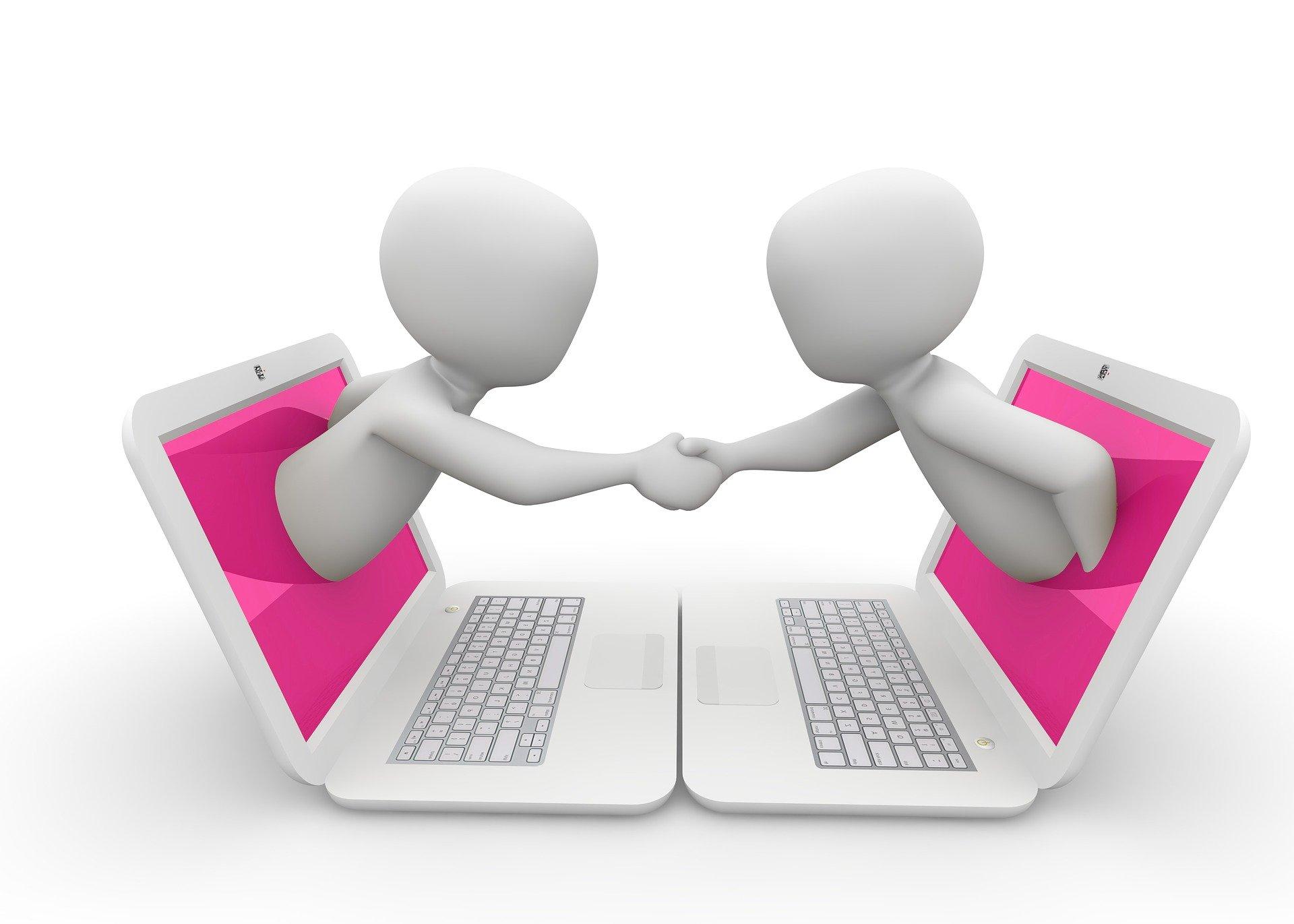 personnages se serrent la main entre 2 ordinateurs